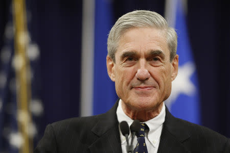 Robert Mueller pauses during his remarks at a farewell ceremony held for him at the Justice Department in Washington