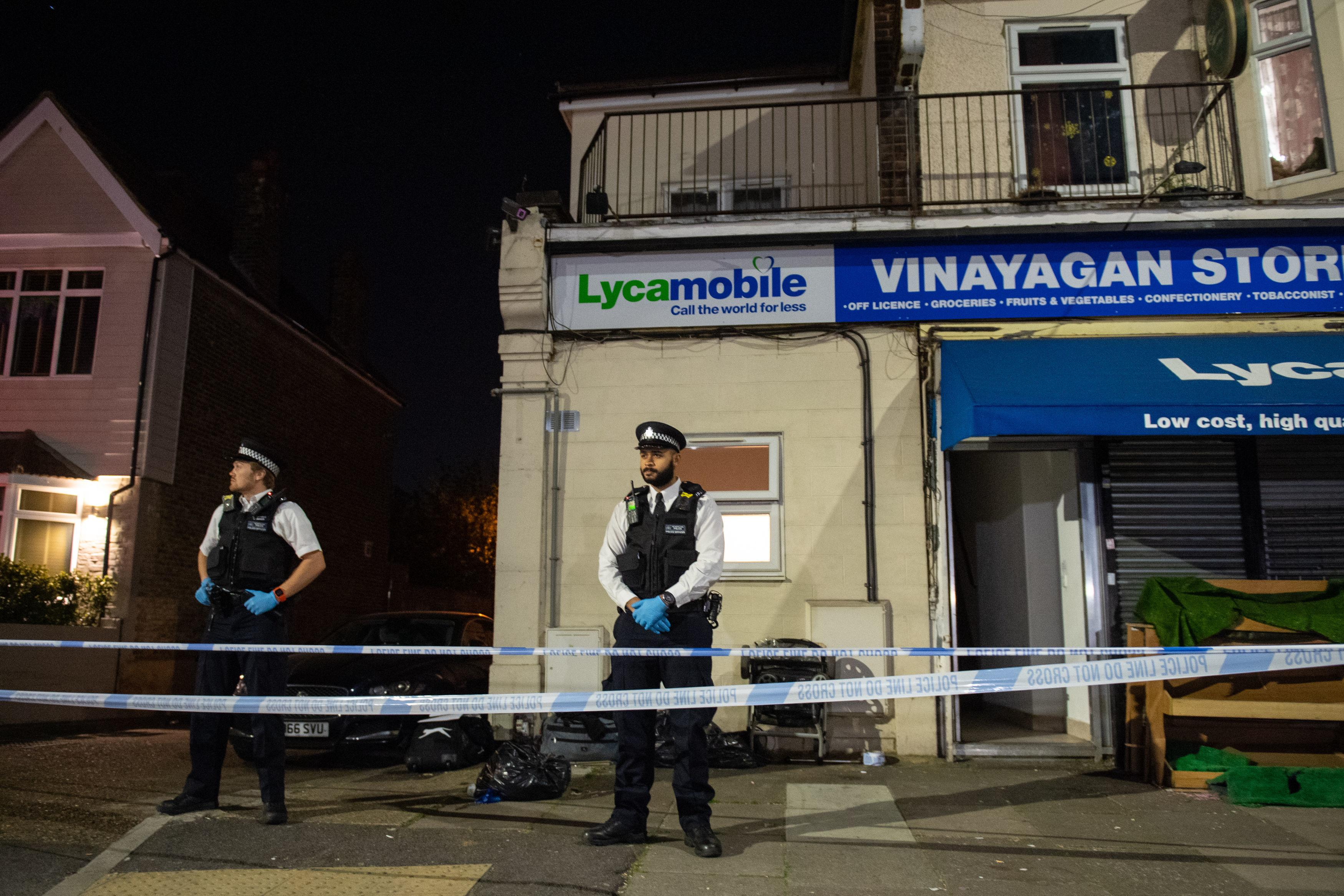 Police attend the scene in Aldborough Road North, Ilford, east London where a baby girl and a boy aged three have been stabbed to death while a 40-year-old man was found injured and was taken to hospital. PA Photo. Picture date: Sunday April 26, 2020. Scotland Yard said the man and the two children were known to each other, and police were not looking for anyone else in connection with the incident. See PA story POLICE Ilford. Photo credit should read: Dominic Lipinski/PA Wire
