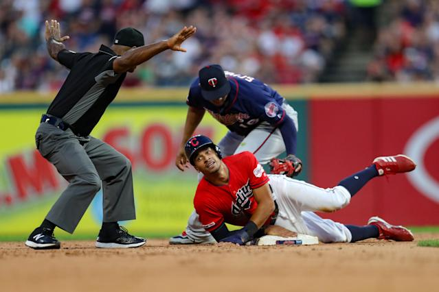 Umpire Alan Porter emphatically signals that Cleveland Indians center fielder Oscar Mercado is safe at second base during a 2019 game. (Photo by Frank Jansky/Icon Sportswire via Getty Images)