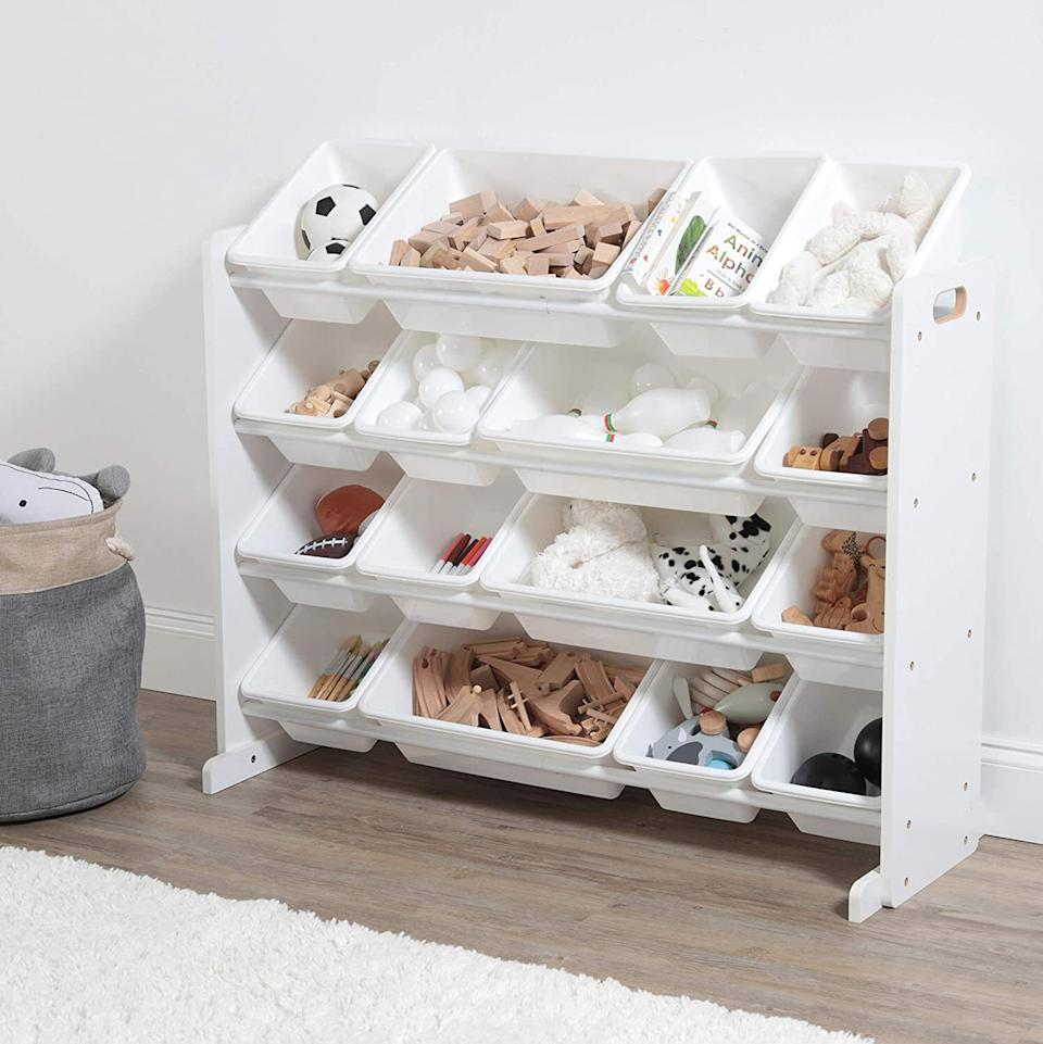 """This four-shelf, 16-bin organizer will make it super easy for your kids to find the toys they're looking for — and, more importantly, they'll be able to see where to put things when they're done playing.<br /><br /><strong>Promising review:</strong>""""I love it!! It was easy to put together and<strong>I'm very happy that the bins are plastic instead of cloth</strong>! It's perfect!"""" —<a href=""""https://amzn.to/3wYyLKO"""" target=""""_blank"""" rel=""""nofollow noopener noreferrer"""" data-skimlinks-tracking=""""5902331"""" data-vars-affiliate=""""Amazon"""" data-vars-href=""""https://www.amazon.com/gp/customer-reviews/R1UJ49Y583FN1D?tag=bfmal-20&ascsubtag=5902331%2C5%2C37%2Cmobile_web%2C0%2C0%2C16540700"""" data-vars-keywords=""""cleaning,fast fashion"""" data-vars-link-id=""""16540700"""" data-vars-price="""""""" data-vars-product-id=""""20969067"""" data-vars-product-img="""""""" data-vars-product-title="""""""" data-vars-retailers=""""Amazon"""">Cara</a><br /><br /><strong>Get it from Amazon for<a href=""""https://amzn.to/2RF2Dfh"""" target=""""_blank"""" rel=""""nofollow noopener noreferrer"""" data-skimlinks-tracking=""""5902331"""" data-vars-affiliate=""""Amazon"""" data-vars-asin=""""B07KKYXZ9W"""" data-vars-href=""""https://www.amazon.com/dp/B07KKYXZ9W?tag=bfmal-20&ascsubtag=5902331%2C5%2C37%2Cmobile_web%2C0%2C0%2C16540691"""" data-vars-keywords=""""cleaning,fast fashion"""" data-vars-link-id=""""16540691"""" data-vars-price="""""""" data-vars-product-id=""""19665215"""" data-vars-product-img=""""https://m.media-amazon.com/images/I/41T6XQLlGCL.jpg"""" data-vars-product-title=""""Humble Crew Extra-Large Toy Organizer, 16 Storage Bins, White/White"""" data-vars-retailers=""""Amazon"""">$59.99+</a>(available in six colors).</strong>"""