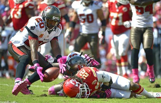 Tampa Bay Buccaneers free safety Ronde Barber (20) scoops up a pass for an interception beside Kansas City Chiefs wide receiver Dexter McCluster (22) before running it back for a 78-yard touchdown during the second half of an NFL football game on Sunday, Oct. 14, 2012, in Tampa, Fla. (AP Photo/Phelan M. Ebenhack)