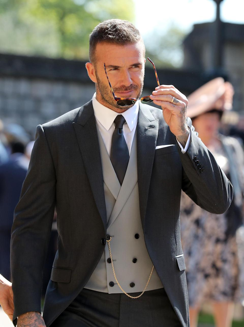David Beckham looks cool in the Windsor sun (Picture: PA)