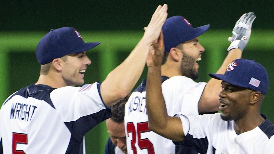 David Wright and Jimmy Rollins high five with Team USA