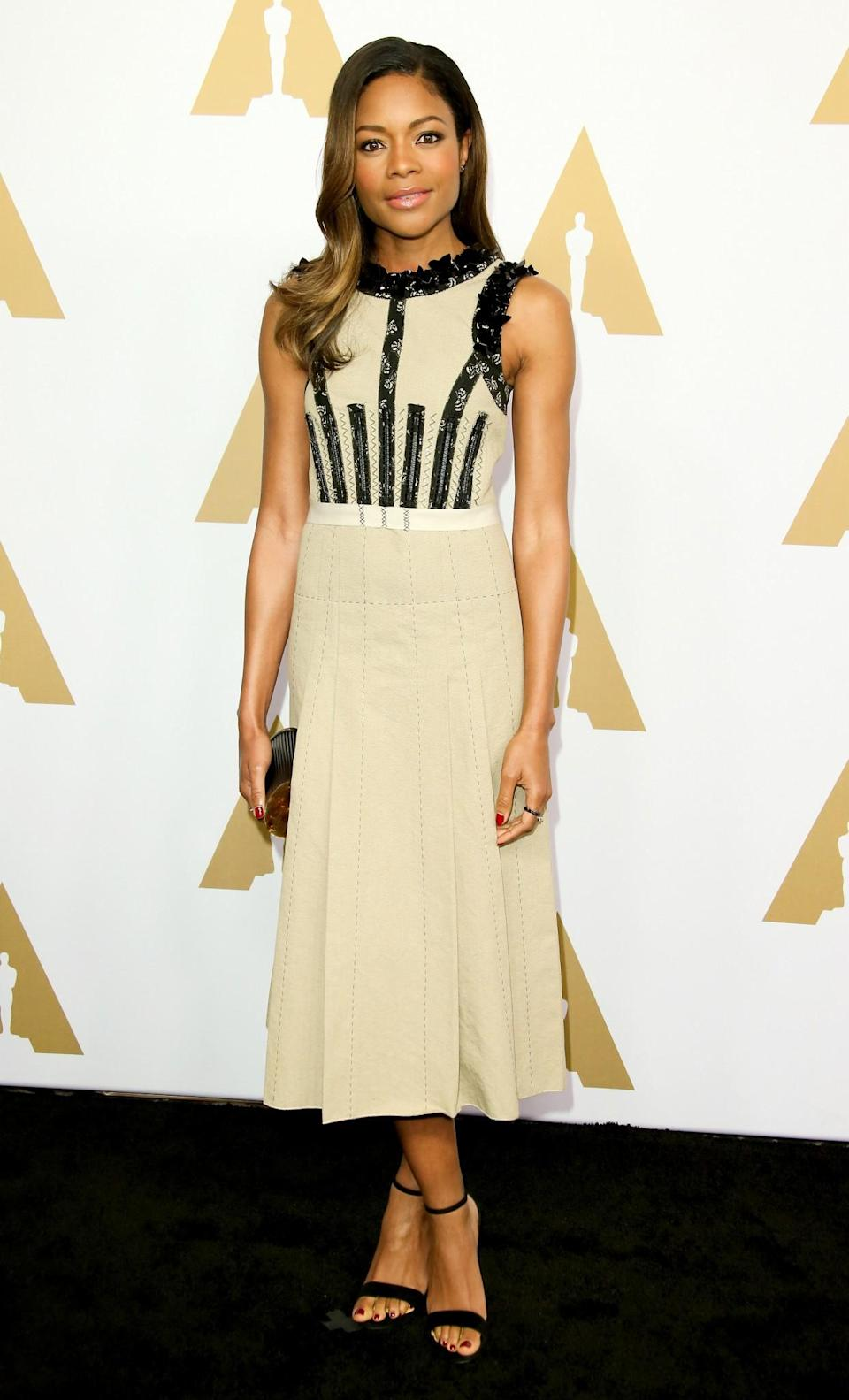 <p>The 'Moonlight' star wore a simple beige dress with lace trim by Bottega Veneta, which she paired with black suede sandals by Rene Caovilla. [Photo: Getty] </p>