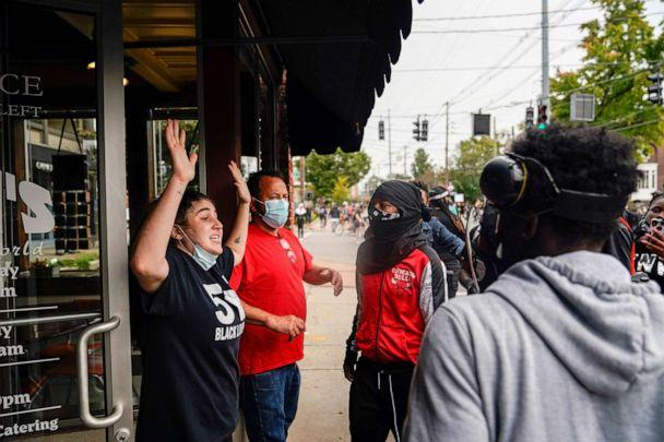 PHOTO: Business owners plead with demonstrators not to destroy their business, as people react after a decision in the criminal case against police officers involved in the death of Breonna Taylor, in Louisville, Ky., Sept. 23, 2020. (Bryan Woolston/Reuters)