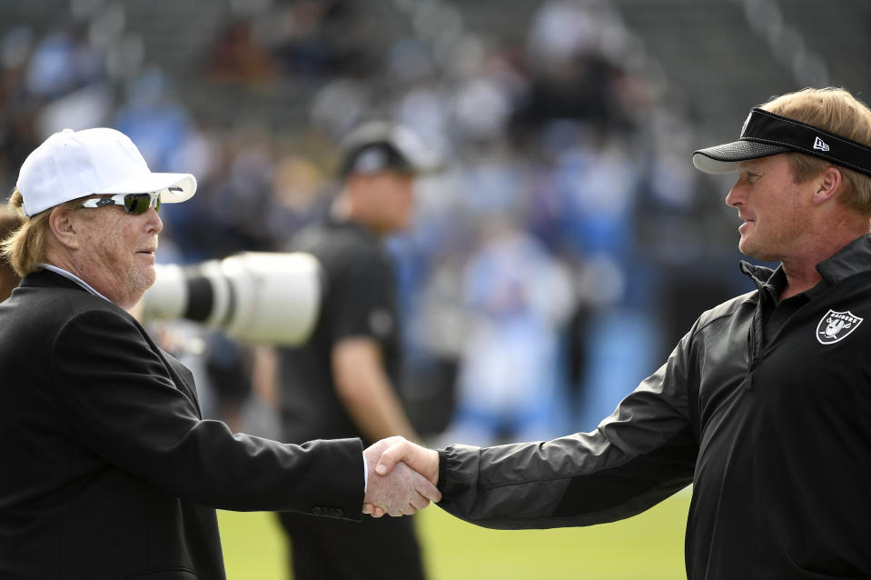 Might Raiders owner Mark Davis, left, or head coach Jon Gruden have anything to do with the team's recent rash of departures? (Photo by Kevork Djansezian/Getty Images)