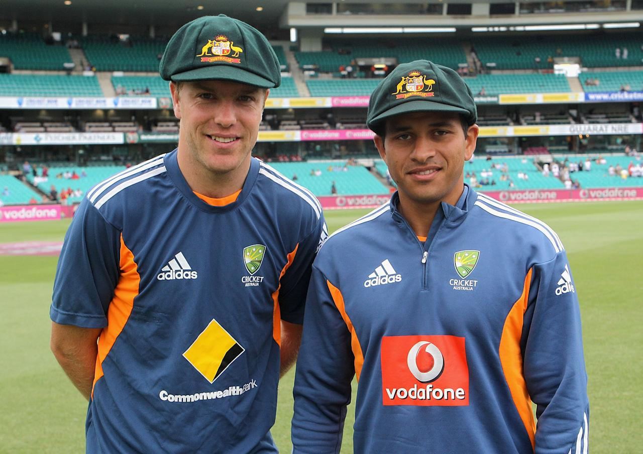SYDNEY, AUSTRALIA - JANUARY 03:  Michael Beer (L) and Usman Khawaja of Australia pose with their newly presented baggy green caps ahead of day one of the Fifth Ashes Test match between Australia and England at the Sydney Cricket Ground on January 3, 2011 in Sydney, Australia.  (Photo by Hamish Blair/Getty Images)