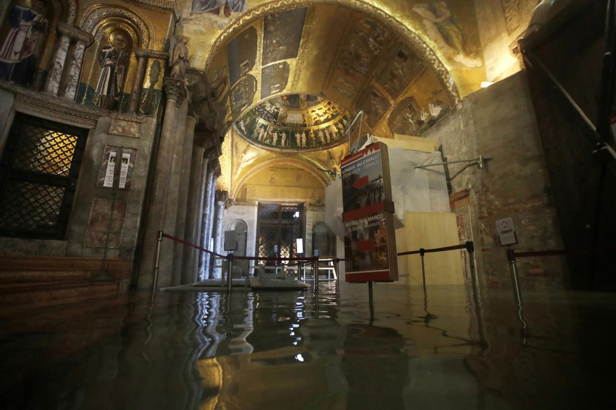 The entrance to St. Mark's Basilica is flooded on the occasion of a high tide, in Venice, Italy, Tuesday, Nov. 12, 2019. (Photo: Luca Bruno/AP)