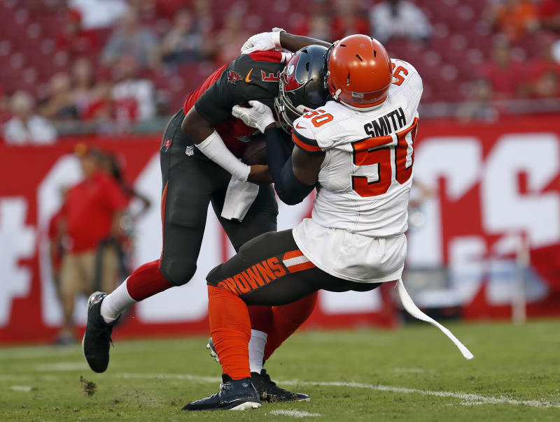Cleveland Browns defensive end Chris Smith drags down Tampa Bay Buccaneers quarterback Jameis Winston. (AP)