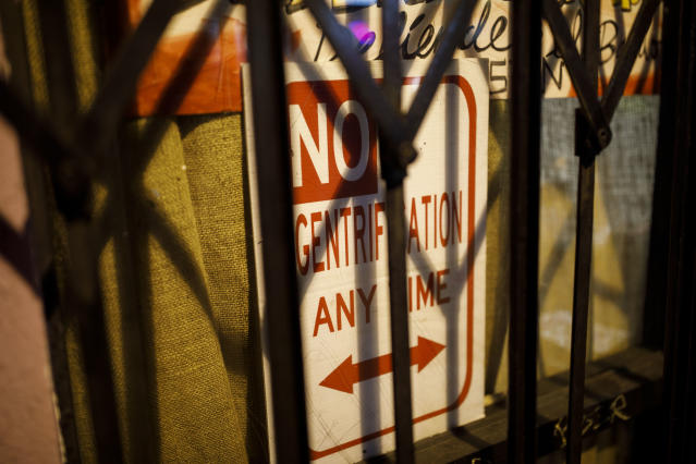 "A sign saying ""No Gentrification Any Time"" is dispayed in the window of the La Conxa Autonomous Community Space in Boyle Heights, Los Angeles. (Photo: Patrick T. Fallon for Yahoo News)"