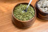 """<p>""""These tasty green seeds should be part of your healthy routine year-round,"""" says Largeman-Roth. """"A ¼ cup of shelled pumpkin seeds contains 180 calories, 9 grams of filling plant protein, 3 grams of fiber, and 14 grams of satisfying fat. The fat in pumpkin seeds is primarily monounsaturated (MUFA) and polyunsaturated fats (PUFA). <a href=""""https://academic.oup.com/jn/article-abstract/148/11/1821/5105881?redirectedFrom=fulltext"""" rel=""""nofollow noopener"""" target=""""_blank"""" data-ylk=""""slk:Research"""" class=""""link rapid-noclick-resp"""">Research</a> has shown that replacing saturated and trans fat in the diet with unsaturated fat, especially PUFA, helps prevent weight gain as we age."""" Here are <a href=""""https://www.prevention.com/food-nutrition/g20485218/roasted-pumpkin-seed-recipes/"""" rel=""""nofollow noopener"""" target=""""_blank"""" data-ylk=""""slk:five easy ways to roast pumpkin seeds"""" class=""""link rapid-noclick-resp"""">five easy ways to roast pumpkin seeds</a>.</p>"""
