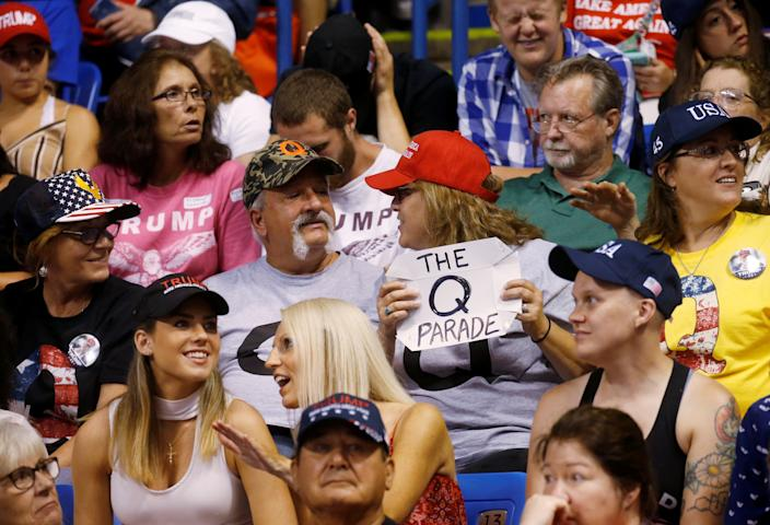 A supporter holds a QAnon sign as President Donald Trump addresses a campaign rally at Mohegan Sun Arena in Wilkes-Barre, Pennsylvania on August 2, 2018. (Leah Millis/Reuters)