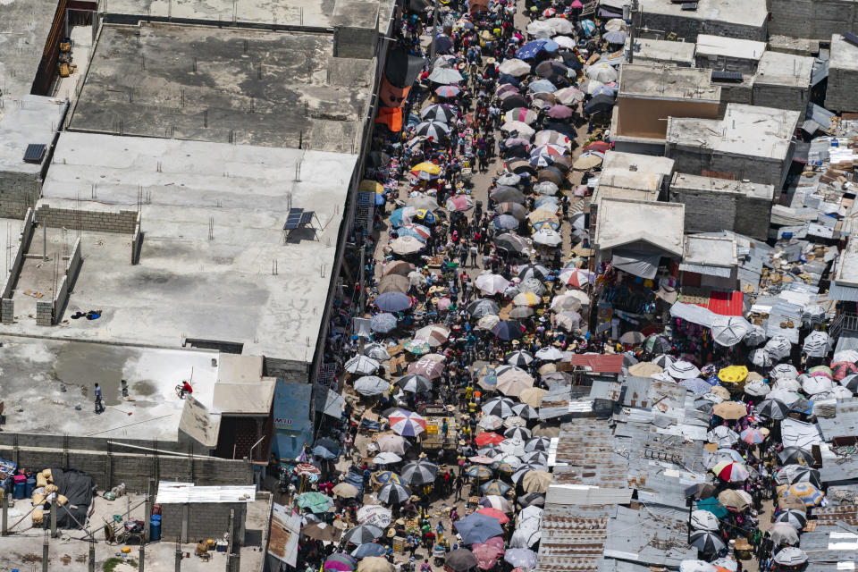 """A crowded street is seen from a VM-22 Osprey on a relief mission after take off from Toussaint Louverture International Airport, Saturday, Aug. 28, 2021, in Port-au-Prince, Haiti. The VMM-266, """"Fighting Griffins,"""" from Marine Corps Air Station New River, from Jacksonville, N.C., are flying in support of Joint Task Force Haiti after a 7.2 magnitude earthquake on Aug. 22, caused heavy damage to the country. (AP Photo/Alex Brandon)"""
