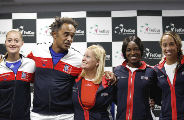 Left to right, France's Team members Kristina Mladenovic, captain Yannick Noah and United States' Fed Cup team members, captain Kathy Rinaldi, Sloane Stephens, Madison Keys, pose for photo after the draw ceremony in Aix-en-Provence, Friday, April 20, 2018. The Fed Cup semifinal matches between France and USA will take place Saturday and next Sunday. (AP Photo/Claude Paris)