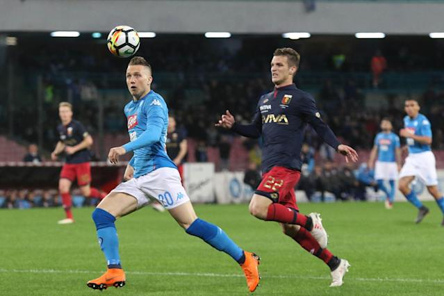Napoli's Piotr Zielinski, left, and Genoa's Darko Lazovic fight for the ball during an Italian Serie A soccer match between Napoli and Genoa, at the San Paolo stadium in Naples, Sunday, March 18, 2018. (Cesare Abbate/ANSA via AP)