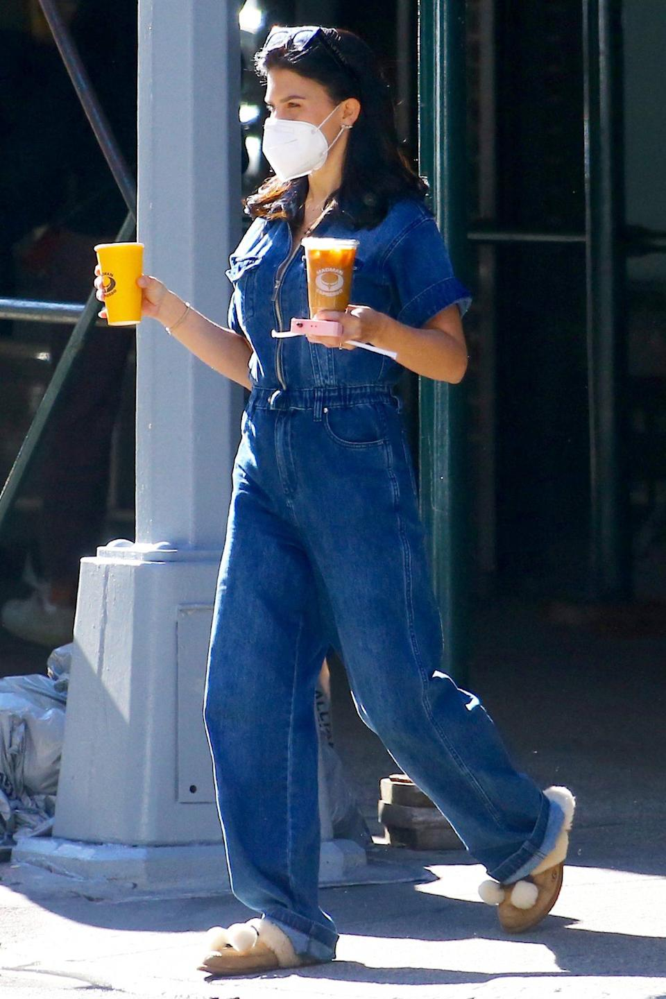 <p>New mom Hilaria Baldwin grabs two coffees in N.Y.C. on Thursday. </p>