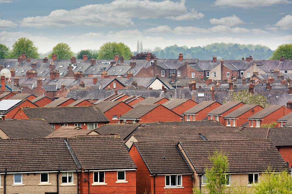 Urban scene across built up area showing the slate roof tops of terraced houses on an old housing estate