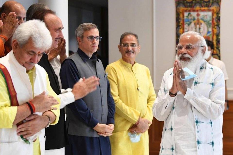 """A handout photo made available by the Indian Prime Minister""""s Office shows Indian Prime Minister Narendra Modi (R ) greeting members of different political parties from Jammu and Kashmir prior to their meeting in New Delhi, India 24 June 2021."""
