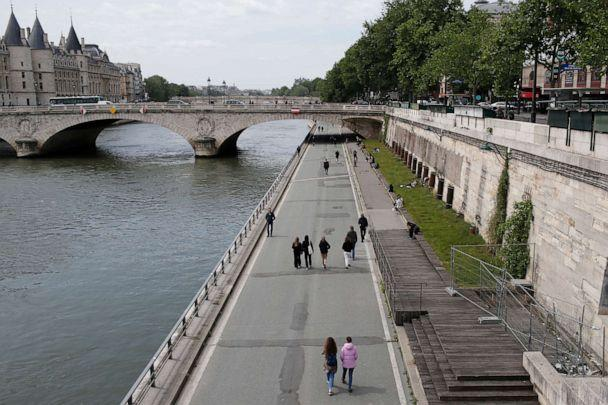 PHOTO: People stroll along the Seine River in Paris, France, on May 11, 2020. (Rafael Yaghobzadeh/AP)