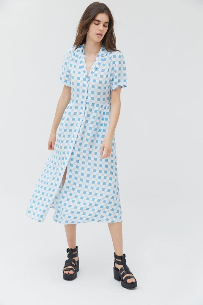 """<p><strong>Urban Outfitters</strong></p><p>urbanoutfitters.com</p><p><strong>$69.00</strong></p><p><a href=""""https://go.redirectingat.com?id=74968X1596630&url=https%3A%2F%2Fwww.urbanoutfitters.com%2Fshop%2Fuo-mila-midi-shirt-dress&sref=https%3A%2F%2Fwww.goodhousekeeping.com%2Fholidays%2Fg32302046%2Ffourth-of-july-outfit-ideas%2F"""" rel=""""nofollow noopener"""" target=""""_blank"""" data-ylk=""""slk:Shop Now"""" class=""""link rapid-noclick-resp"""">Shop Now</a></p><p>A flowy, light blue and white dress like this one will keep you cool on a hot July day. Wear it with a red purse to hit the Fourth of July color trifecta, and throw on a pair of <a href=""""https://go.redirectingat.com?id=74968X1596630&url=https%3A%2F%2Fwww.zappos.com%2Fp%2Fsuperga-2790-acotw-platform-sneaker-white%2Fproduct%2F8674418%2Fcolor%2F14&sref=https%3A%2F%2Fwww.goodhousekeeping.com%2Fholidays%2Fg32302046%2Ffourth-of-july-outfit-ideas%2F"""" rel=""""nofollow noopener"""" target=""""_blank"""" data-ylk=""""slk:white sneakers"""" class=""""link rapid-noclick-resp"""">white sneakers</a> so you are ready for whatever the day brings. </p><p><strong>RELATED</strong>: <a href=""""https://www.goodhousekeeping.com/clothing/g32106035/best-slip-on-sneakers/"""" rel=""""nofollow noopener"""" target=""""_blank"""" data-ylk=""""slk:12 Slip-On Sneakers You're Going to Want to Wear All the Time"""" class=""""link rapid-noclick-resp"""">12 Slip-On Sneakers You're Going to Want to Wear All the Time</a></p>"""