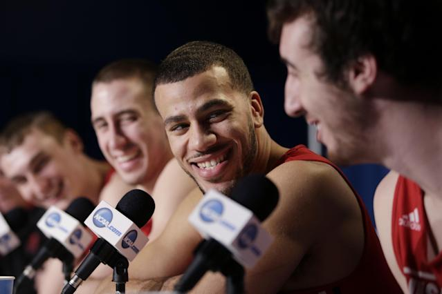 Wisconsin's Traevon Jackson, center, smiles while listening to teammate Frank Kaminsky, right, during a news conference at the NCAA college basketball tournament on Friday, March 28, 2014, in Anaheim, Calif. Wisconsin plays Arizona in a regional final on Saturday. (AP Photo/Jae C. Hong)