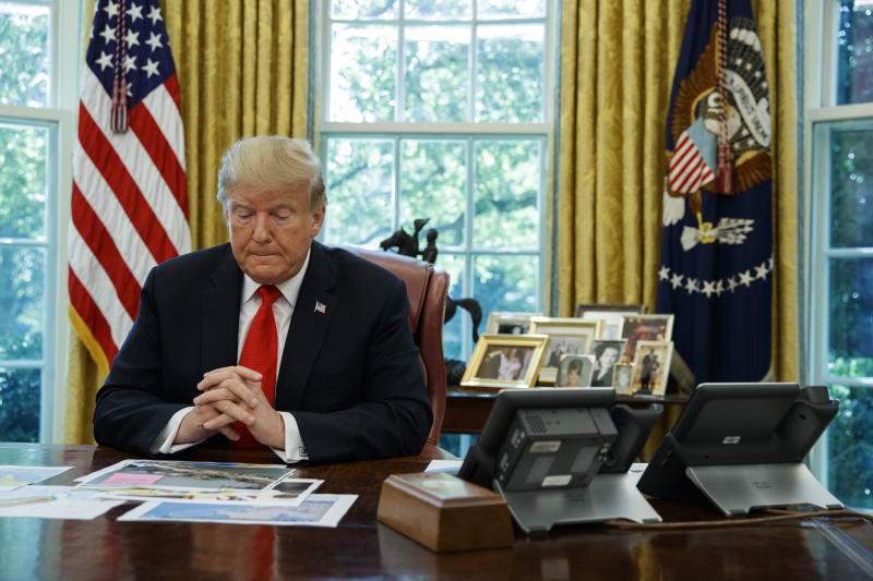 President Donald Trump listens during a briefing on Hurricane Dorian in the Oval Office of the White House, Wednesday, Sept. 4, 2019, in Washington. (AP Photo/Evan Vucci)