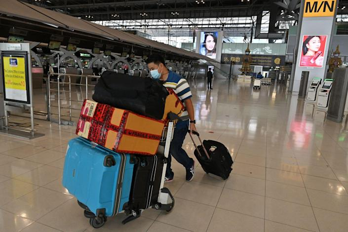 A traveller arrives at the check-in area of Suvarnabhumi Airport in Bangkok on June 30, 2021, amid an ongoing downturn in international tourism in Thailand due to the Covid-19 coronavirus pandemic.