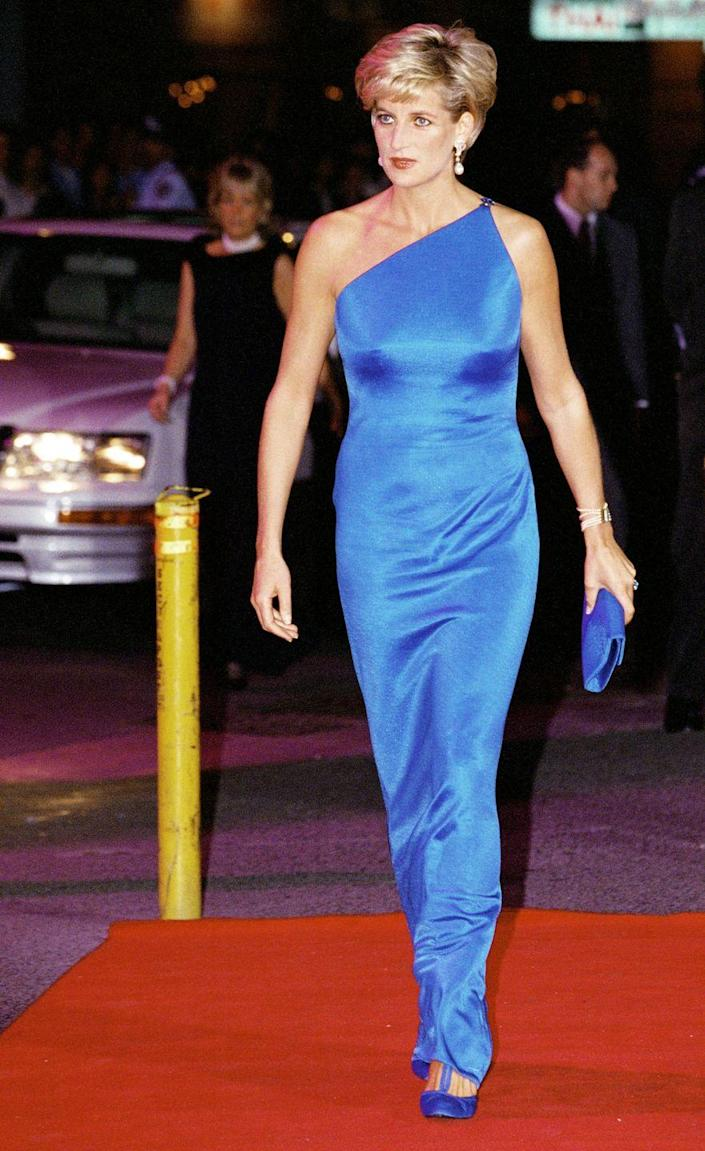 <p>Princess Diana wowed in an electric blue dress by Versace while at a dinner in Sydney, Australia in 1996. </p>