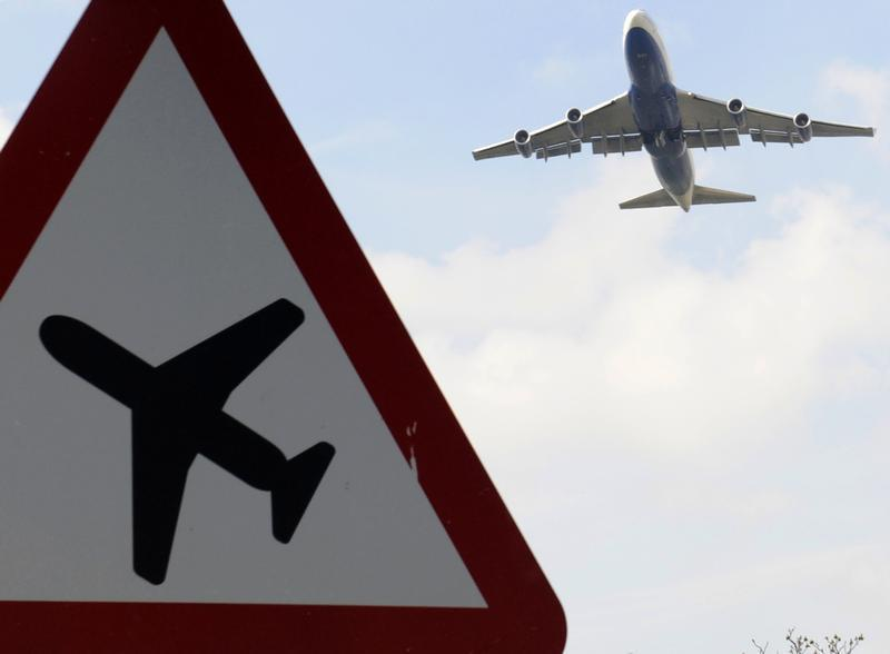 A jumbo jet takes off shortly before midday from Heathrow Airport in west London