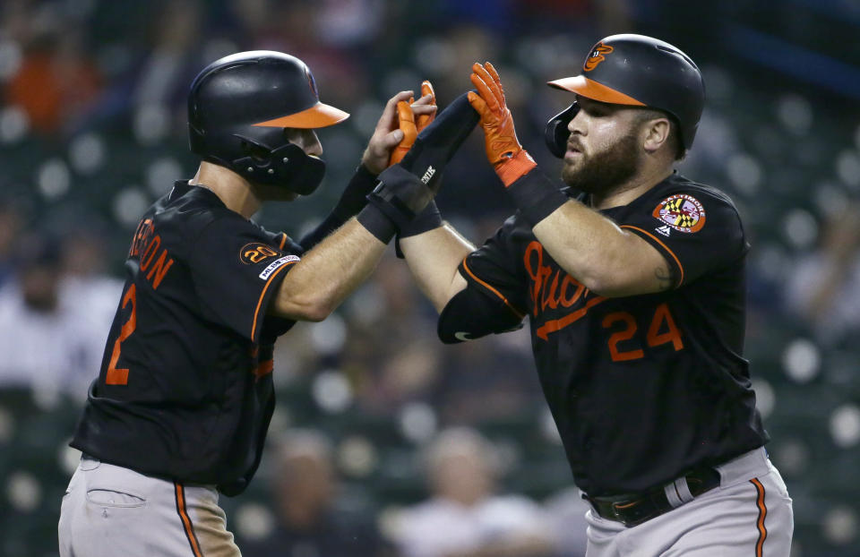 Baltimore Orioles' DJ Stewart (24) celebrates his two-run home run against the Detroit Tigers with Stevie Wilkerson during the fifth inning of a baseball game Friday, Sept. 13, 2019, in Detroit. (AP Photo/Duane Burleson)