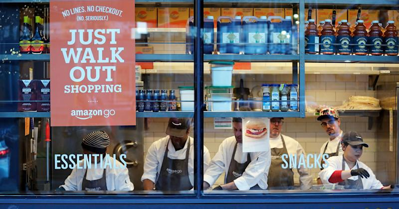 FILE - In this Jan. 22, 2018, file photo, workers as seen from a sidewalk window as they assemble sandwiches in an Amazon Go store in Seattle. A key executive behind Amazon Go, the online leader's much heralded cashier-less grocery store, says she was surprised how many customers were hesitant to just walk out the store. (AP Photo/Elaine Thompson, File)