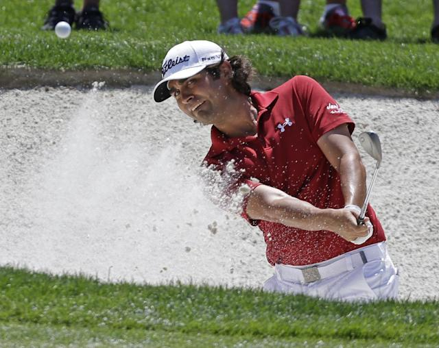 Martin Flores hits from a sand trap on the fifth hole during the final round of the Wells Fargo Championship golf tournament in Charlotte, N.C., Sunday, May 4, 2014. (AP Photo/Bob Leverone)
