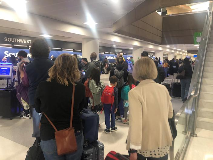 Travelers check in for Southwest Airlines flights at Phoenix Sky Harbor International Airport on Thursday, March 11.