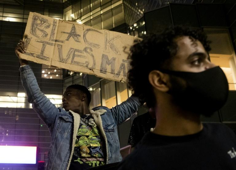 Protesters in Detroit rally over the death of 46-year-old George Floyd at the hands of police in Minneapolis, Minnesota (AFP Photo/Matthew Hatcher)