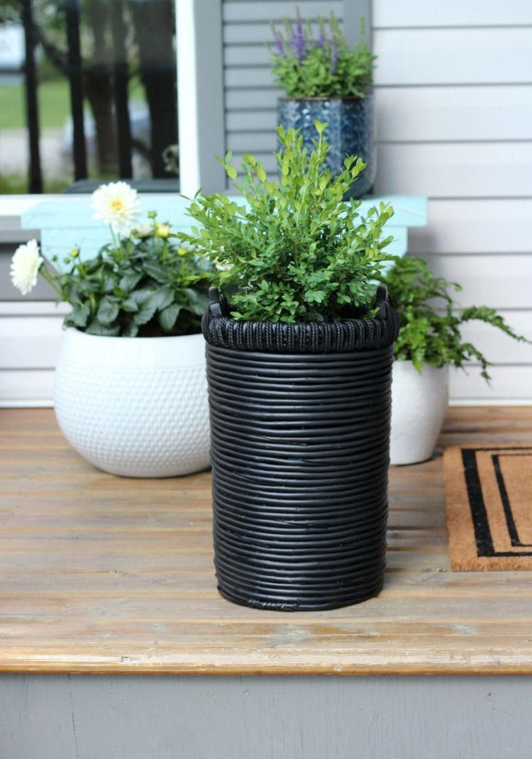"""<p>For this DIY, a basket found at a flea market receives a top-to-bottom makeover with a couple coats of semi-flat black spray paint. </p><p><strong>Get the tutorial at <a href=""""https://satoridesignforliving.com/flea-market-basket-planter-front-porch-decor/"""" rel=""""nofollow noopener"""" target=""""_blank"""" data-ylk=""""slk:Satori Design for Living"""" class=""""link rapid-noclick-resp"""">Satori Design for Living</a>.</strong></p><p><a class=""""link rapid-noclick-resp"""" href=""""https://go.redirectingat.com?id=74968X1596630&url=https%3A%2F%2Fwww.walmart.com%2Fsearch%2F%3Fquery%3Dsemi%2Bflat%2Bblack%2Bpaint&sref=https%3A%2F%2Fwww.thepioneerwoman.com%2Fhome-lifestyle%2Fgardening%2Fg36556911%2Fdiy-planters%2F"""" rel=""""nofollow noopener"""" target=""""_blank"""" data-ylk=""""slk:SHOP BLACK PAINT"""">SHOP BLACK PAINT</a></p>"""