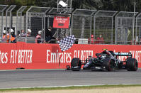 Mercedes driver Valtteri Bottas of Finland crosses the finish line to take second place in the Emilia Romagna Formula One Grand Prix, at the Enzo and Dino Ferrari racetrack, in Imola, Italy, Sunday, Nov.1, 2020. (Miguel Medina, Pool via AP)