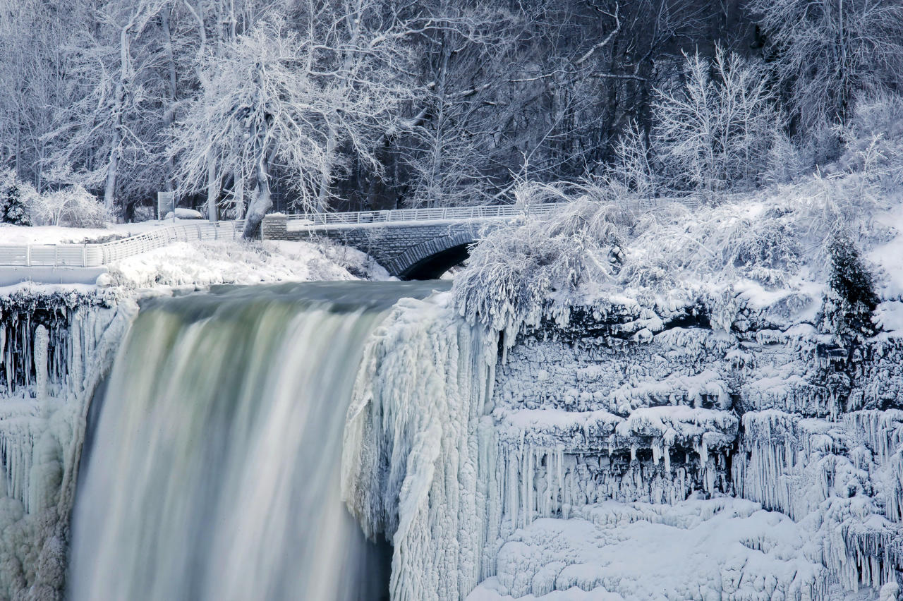 <p>Water flows over the over the Bridal Veil Falls in Niagara Falls, N.Y., viewed from the Canadian side in Niagara Falls, Ont., Tuesday, Tuesday, Jan. 2, 2018. (Aaron Lynett/The Canadian Press via AP) </p>