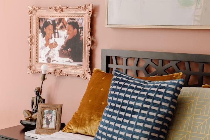 "A still from Taylor's favorite movie, Love Jones, is framed next to her headboard. The addition of the headboard ""is something so small that just makes the room more welcoming,"" she says."