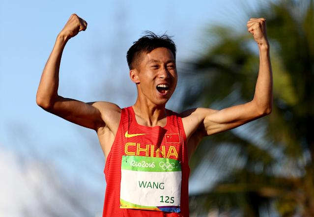 <p>Zhen Wang of China celebrates winning gold in the Men's 20km Race Walk on Day 7 of the Rio 2016 Olympic Games at Pontal on August 12, 2016 in Rio de Janeiro, Brazil. (Getty) </p>
