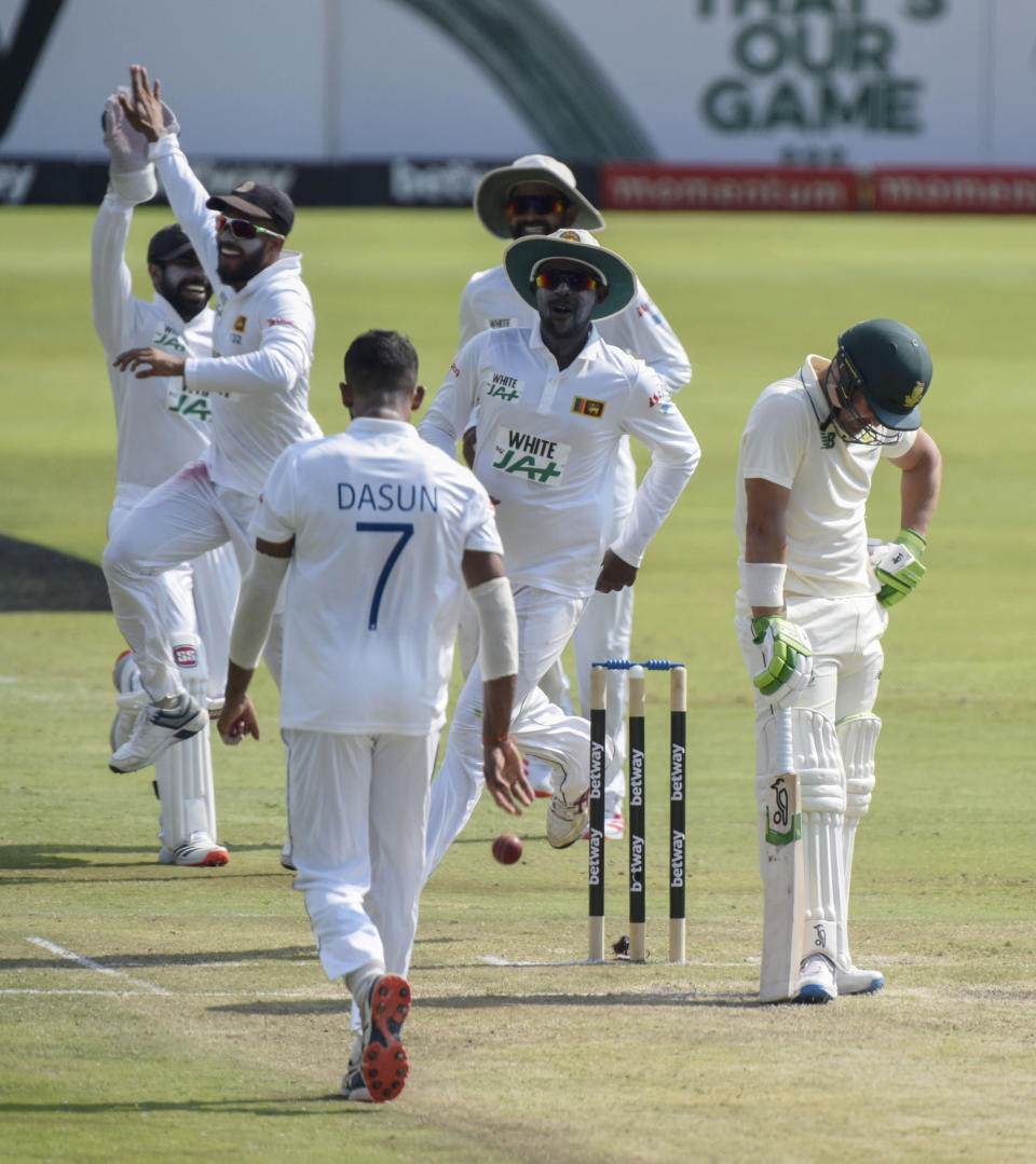 South Africa's Dean Elgar, right, is caught out by Sri Lanka's Dasun Shanaka, on day two of the first cricket test match between South Africa and Sri Lanka at Super Sport Park Stadium in Pretoria, South Africa, Sunday, Dec. 27, 2020. (AP Photo/Catherine Kotze)