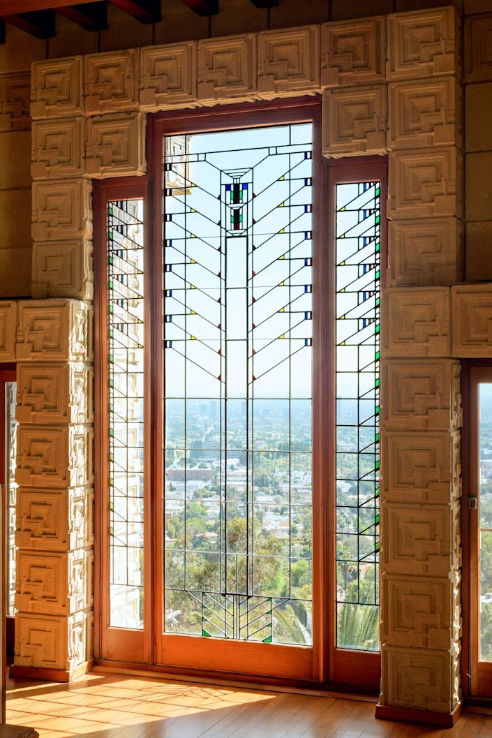 "<h1 class=""title"">Ennis House. Judson Studios.</h1> <div class=""caption""> The restored stained glass dining room windows, with a view of Los Angeles, in Frank Lloyd Wright's Ennis House. </div> <cite class=""credit"">Photo: Alexander Vertikoff, © Vertikoff Archive.</cite>"