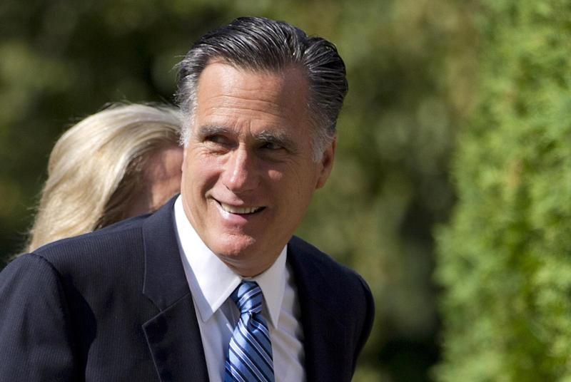 FILE - In this Aug. 26, 2012 file photo, Republican presidential candidate, former Massachusetts Gov. Mitt Romney, and his wife Ann walk to church in Wolfeboro, N.H. On Thursday, Romney will accept his party's presidential nomination.   (AP Photo/Evan Vucci, File)