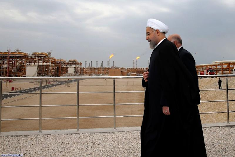 Iranian President Hassan Rouhani (L) walking with Oil Minister Bijan Namdar Zanaganeh (R) at phase 12 of the South Pars gas field facilities in the southern Iranian port of Assaluyeh last year (AFP Photo/HO)
