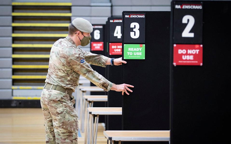 Members of the Royal Scots Dragoon Guard carry out a reconnaissance before setting up a Covid-19 vaccination centreat the Ravenscraig Regional Sports Facility - Jane Barlow/ PA