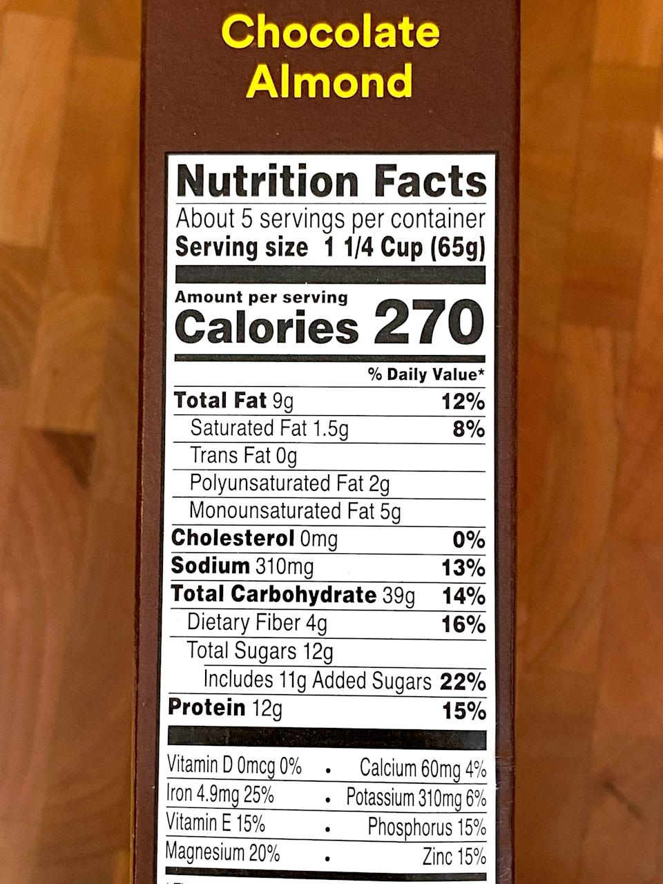 """<p>For a one-and-a-quarter-cup serving of Chocolate Almond RX Cereal, it's 270 calories with nine grams of fat and 1.5 grams of saturated fat. It offers 39 grams of carbs, four grams of fiber, 12 grams of protein, and has just 11 grams of added sugar. </p> <p>If you enjoy your bowl of cereal with one cup of <a href=""""https://silk.com/plant-based-products/soymilk/organic-unsweet-vanilla-soymilk?gclid=Cj0KCQjwpreJBhDvARIsAF1_BU0nyknLgtpqyMhza83oIvp0Xy5qR4HA9Bwm0G7HptWIZbfNBbS9OsUaAvhhEALw_wcB&amp;gclsrc=aw.ds"""" class=""""link rapid-noclick-resp"""" rel=""""nofollow noopener"""" target=""""_blank"""" data-ylk=""""slk:unsweetened soy milk"""">unsweetened soy milk</a>, it adds another 80 calories, four grams of fat, .5 grams of saturated fat, four grams of carbs, two grams of fiber, seven grams of protein, and has no added sugar.</p> <p>For fewer calories, you can enjoy your bowl with <a href=""""https://www.amazon.com/Almond-Almondmilk-Unsweetened-Vanilla-32-Ounce/dp/B002H062DA"""" class=""""link rapid-noclick-resp"""" rel=""""nofollow noopener"""" target=""""_blank"""" data-ylk=""""slk:unsweetened vanilla almond milk"""">unsweetened vanilla almond milk</a>. It adds 30 calories, 2.5 grams of fat, no saturated fat, one gram of carb, less than one gram of fiber, one gram of protein, and has no added sugar.</p>"""