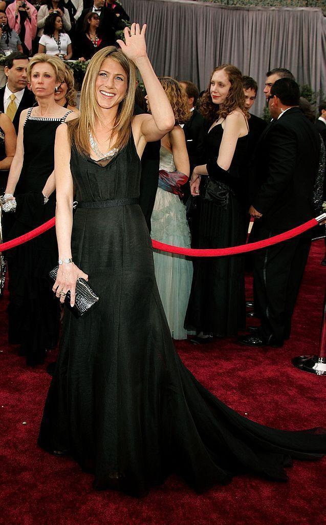 <p>Though she was on the Oscars party scene with Brad Pitt in the late nineties, Aniston's first Academy Awards red carpet was in 2006 when she wore this black Rochas gown with Bulgari jewellery.</p>
