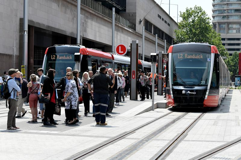 Passengers are seen disembarking the new Sydney light rail. Source: AAP