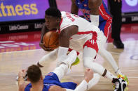 Houston Rockets guard Victor Oladipo (7) controls the ball after running into Detroit Pistons forward Blake Griffin during the second half of an NBA basketball game, Friday, Jan. 22, 2021, in Detroit. (AP Photo/Carlos Osorio)