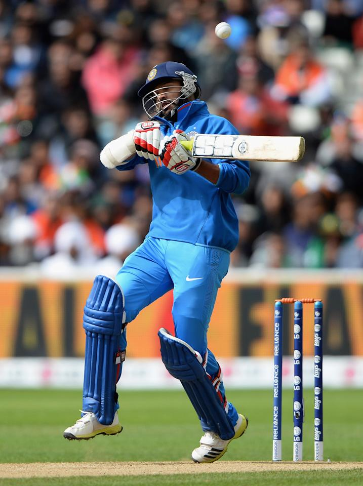 Shikhar Dhawan of India avoids a short ball from Mohammad Irfan of Pakistan during the ICC Champions Trophy match between India and Pakiatan at Edgbaston on June 15, 2013 in Birmingham, England.  (Photo by Gareth Copley/Getty Images)