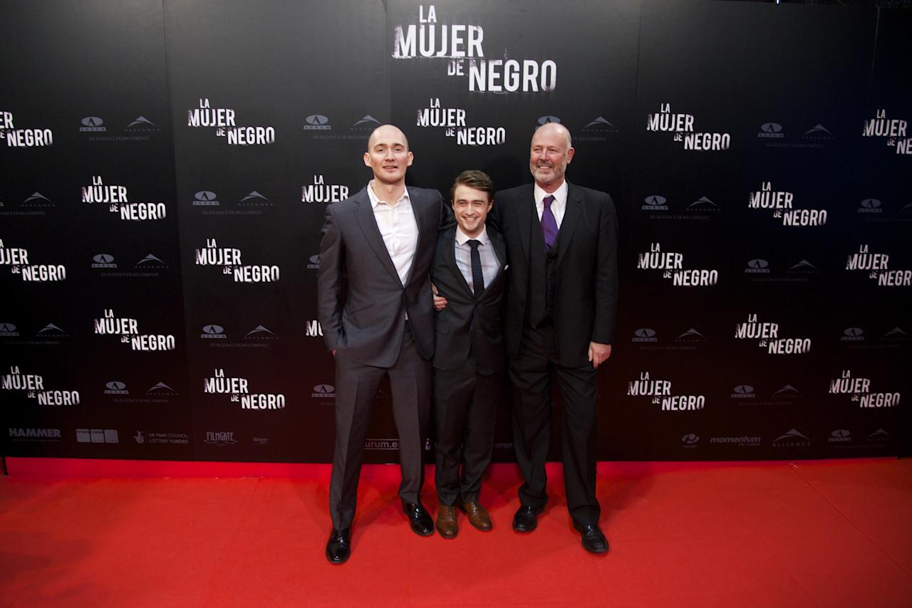 """MADRID, SPAIN - FEBRUARY 14:  (L to R) Director James Watkins, actor Daniel Radcliffe and producer Simon Oakes attend """"The Woman in Black"""" (La Mujer de Negro) premiere at Callao cinema on February 14, 2012 in Madrid, Spain.  (Photo by Carlos Alvarez/Getty Images)"""